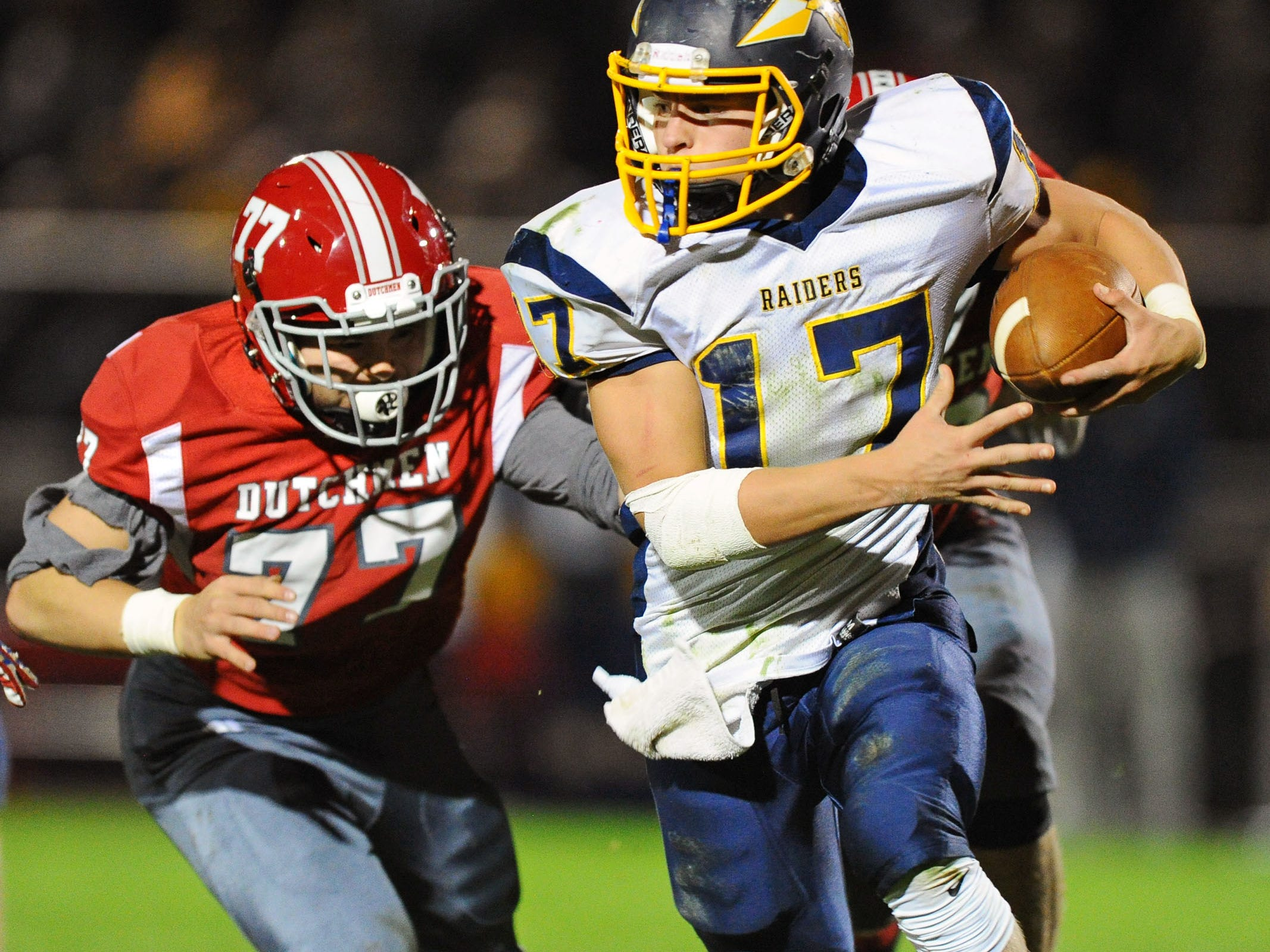 Elco QB Braden Bohannon tries to elude A-C's Seth Jamison(77) during first half action during in Week 9.