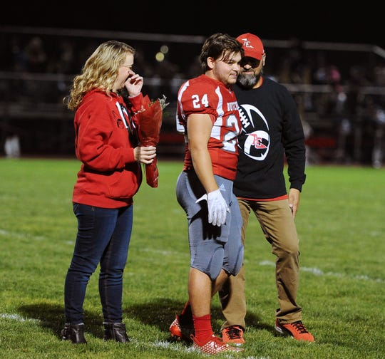Annville-Cleona senior Caleb Turner with his parents on Senior Night before a game played Friday Oct.19, 2018 at Annville Cleona H.S. Support from parents is quite important for any athlete, and the athlete's experience is enhanced when the parents and the coach are on the same page.