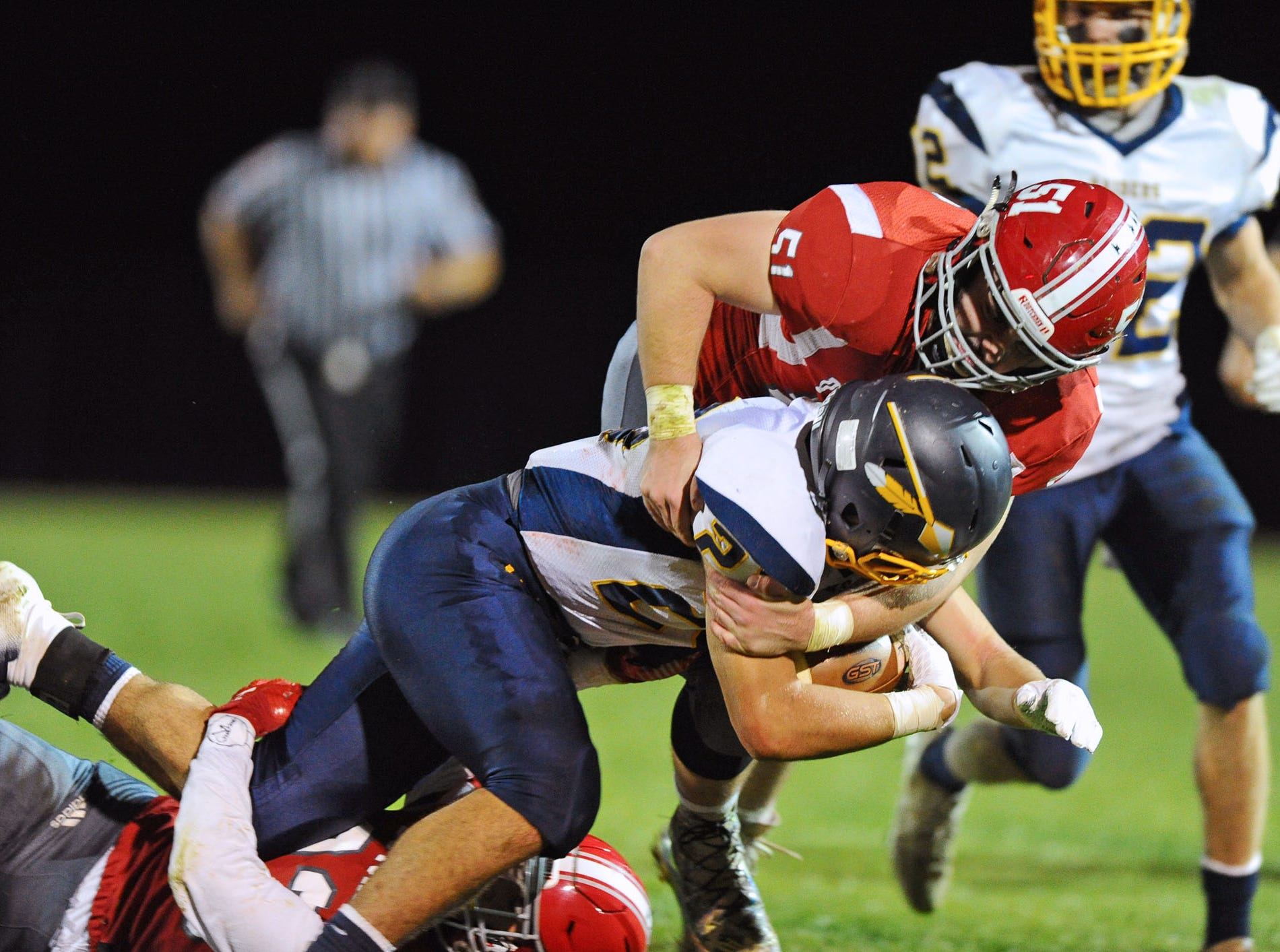 Annville-Cleona's Connor Williams(51) makes a tackle on Elco running back Jordan Fernandez back in October. Williams was named second team all-state in  PAFootballNews.com Coaches Select voting that was announced on Wednesday.