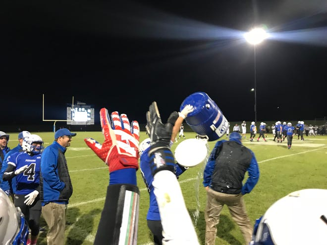 The Croswell-Lexington Pioneers began to celebrate their fourth consecutive playoff victory late in the game, when coach Garrett Grundman received a surprised shower with moments left to play.