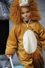 Valerie Mayer, 4, of Port Huron dressed as a lion during Truck-or-Treat, Saturday, Oct. 20, 2018 in downtown Port Huron.