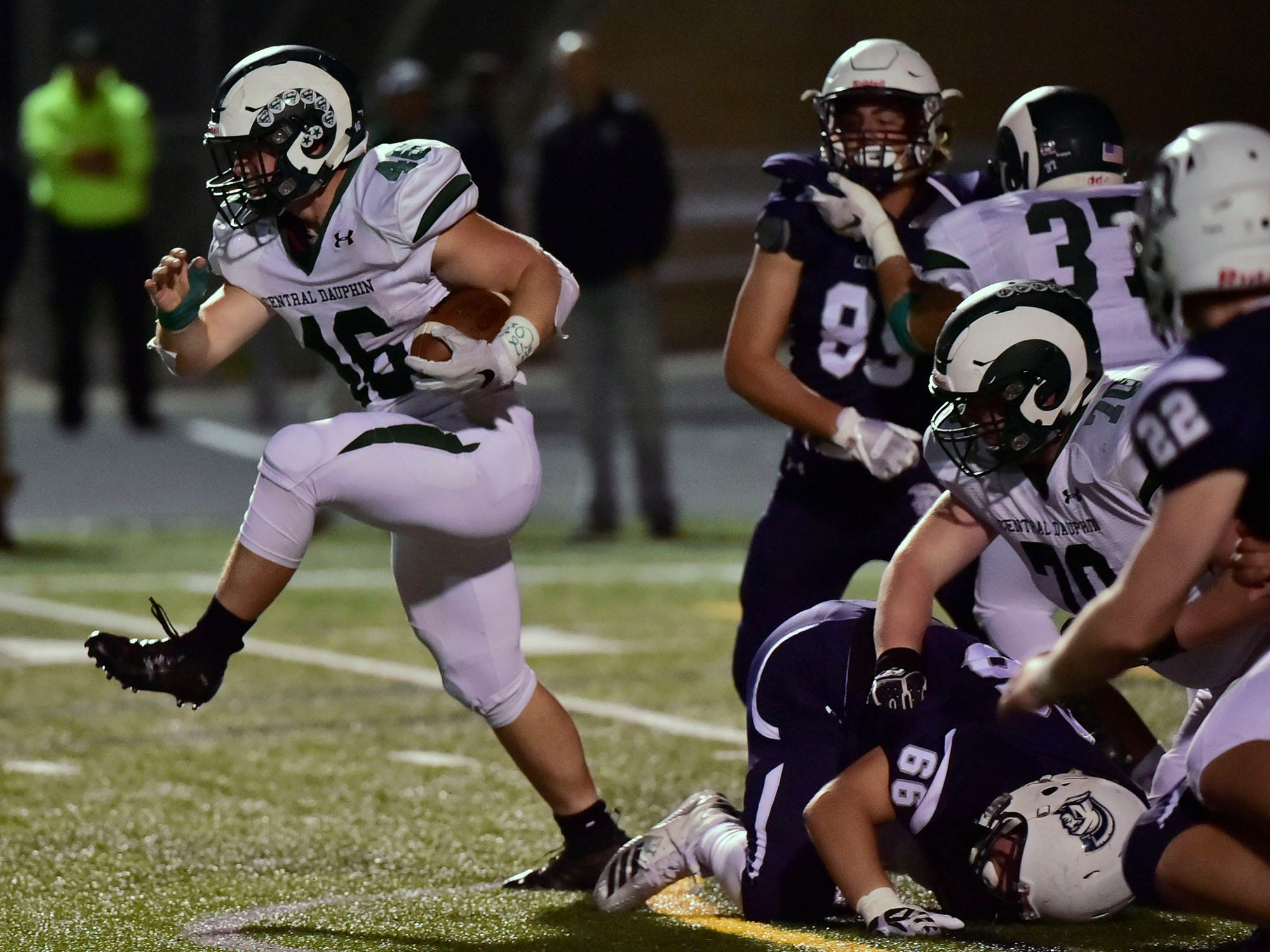 Central Dauphin's Adam Burkhart (46) powers past Chambersburg defenders. Chambersburg lost to Central Dauphin 35-14 in PIAA football on Friday, Oct. 19, 2018.