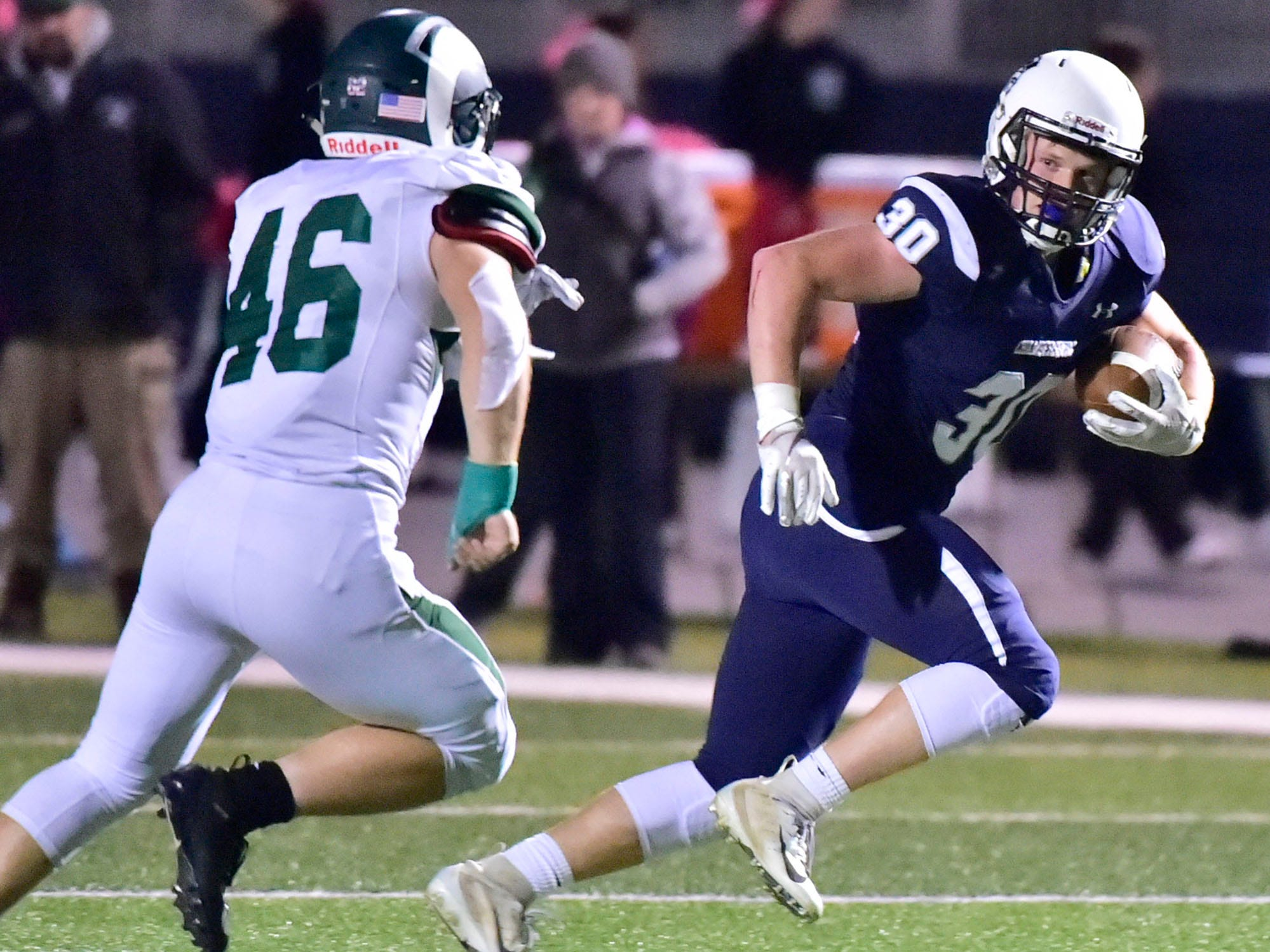 Chambersburg's Tanner Hunt (30) runs the ball for the Trojans. Chambersburg lost to Central Dauphin 35-14 in PIAA football on Friday, Oct. 19, 2018.