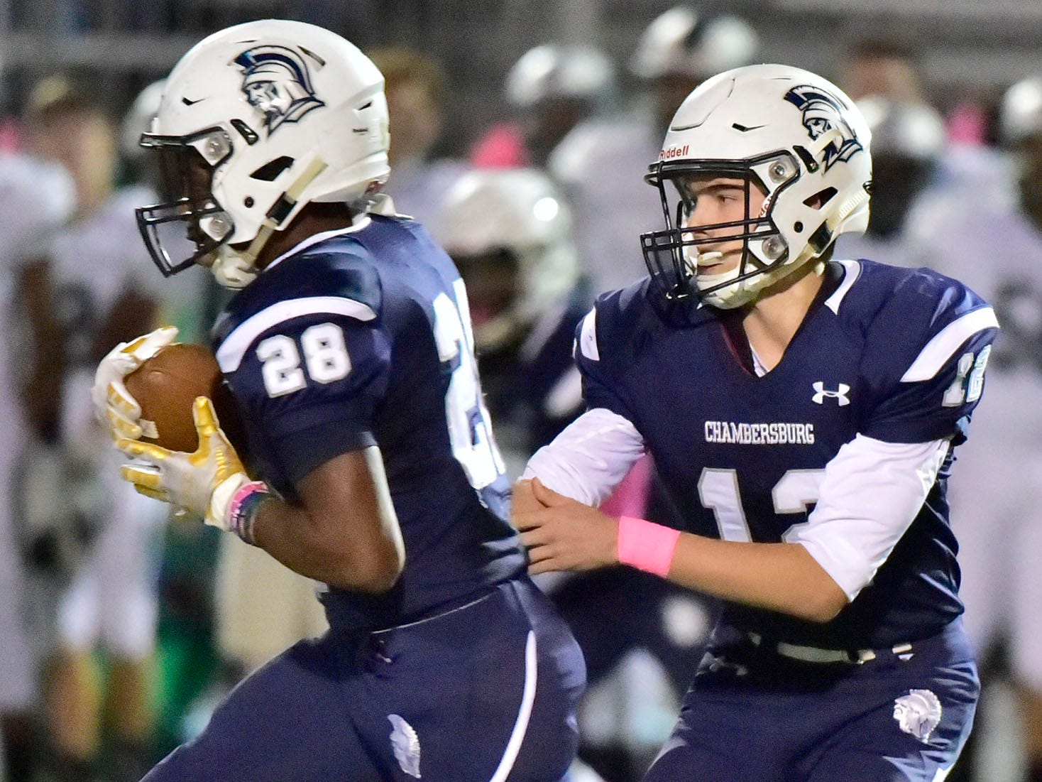 Chambersburg's Keyshawn Jones (28)  carries the ball after a handoff from Brady Stumbaugh. Chambersburg lost to Central Dauphin 35-14 in PIAA football on Friday, Oct. 19, 2018.