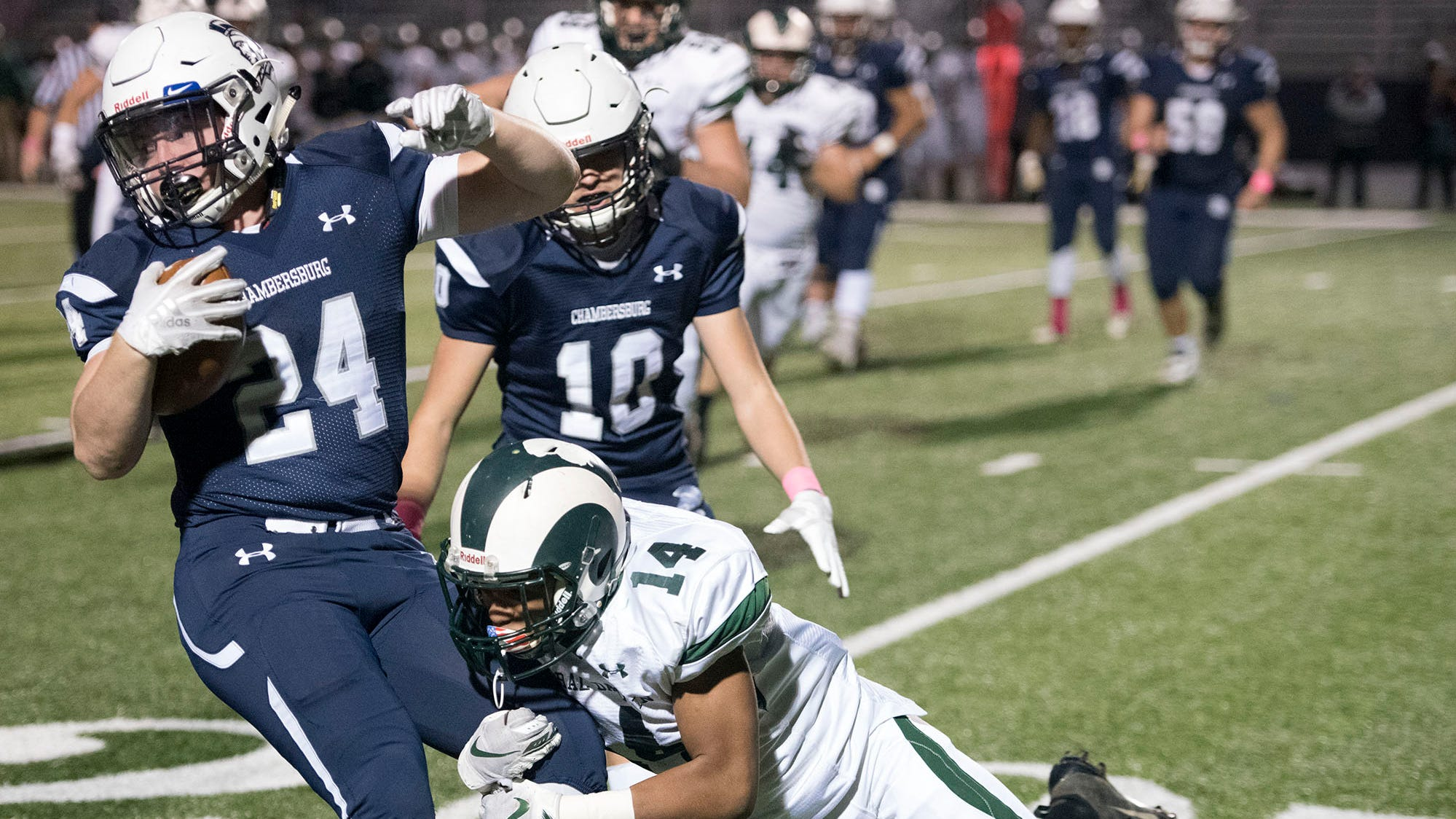 Chambersburg's Andrew Shetter (24) gains yards before being tackled by CD's Malachi Bowman (14). Chambersburg lost to Central Dauphin 35-14 in PIAA football on Friday, Oct. 19, 2018.