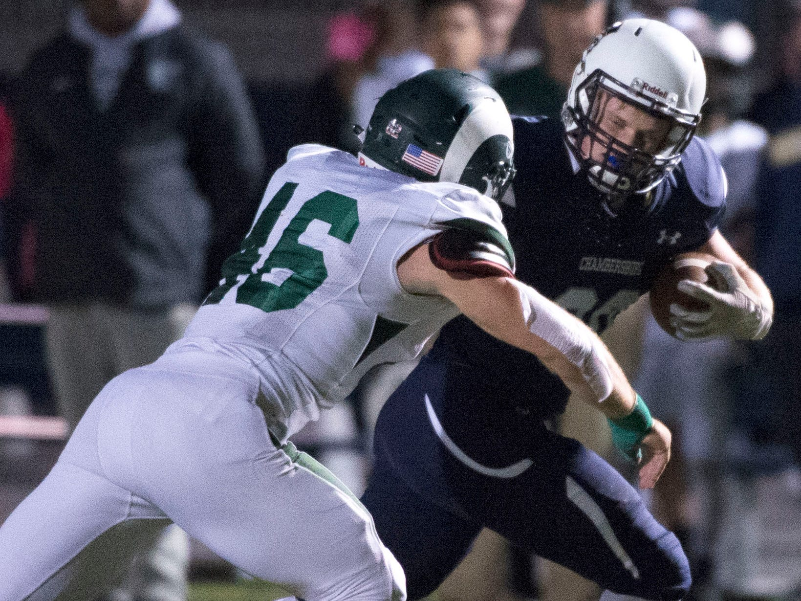 Chambersburg's Tanner Hunt (30) runs the ball past CD's Adam Burkhart (46) after catching a pass. Chambersburg lost to Central Dauphin 35-14 in PIAA football on Friday, Oct. 19, 2018.