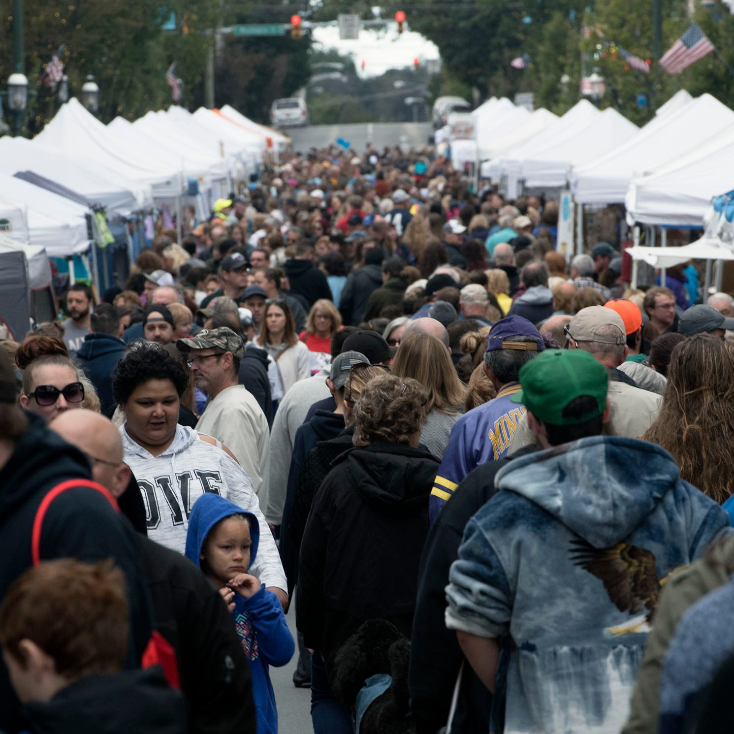 Crowds walk along South Main Street. Applefest started Saturday morning October 20, 2018 in downtown Chambersburg.