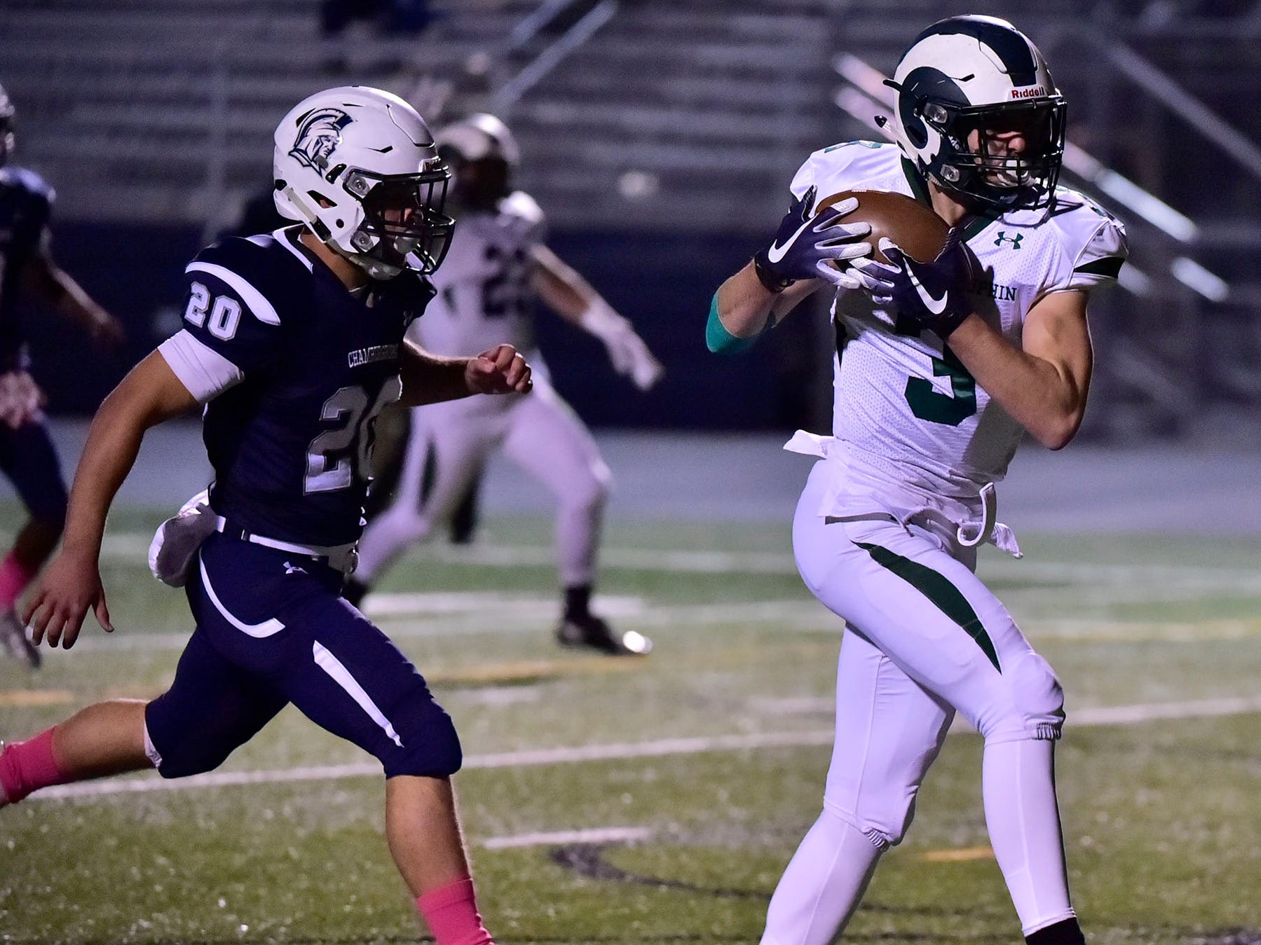 Central Dauphin's Nick Chimienti (3) catches a touchdown pass as Chambersburg's Kyere Morton (20) moves in. Chambersburg lost to Central Dauphin 35-14 in PIAA football on Friday, Oct. 19, 2018.