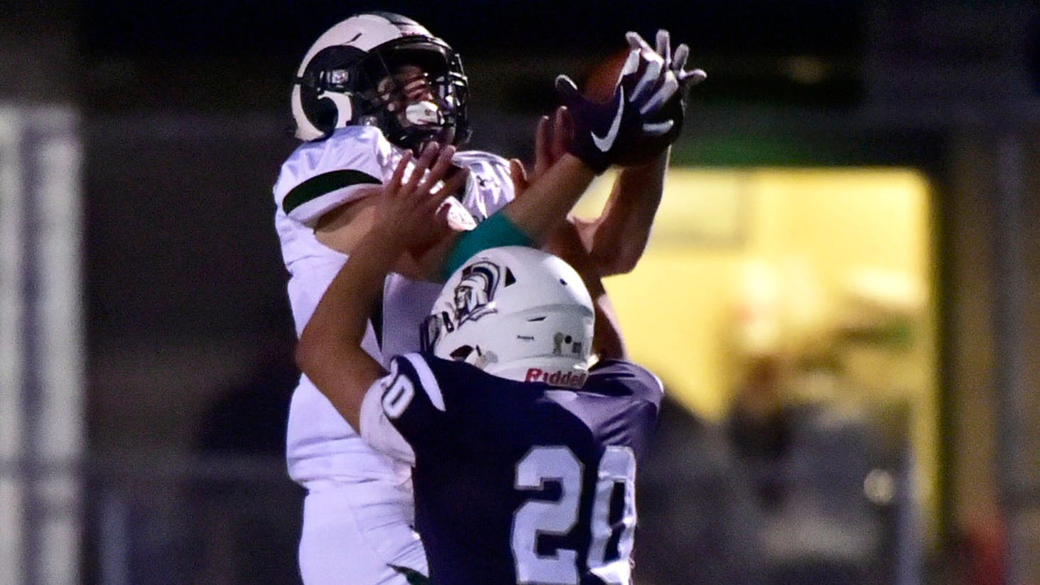 Central Dauphin's Nick Chimienti (3) catches a long pass as Chambersburg's Kyere Morton (20) defends. Chambersburg lost to Central Dauphin in PIAA football on Friday, Oct. 19, 2018.