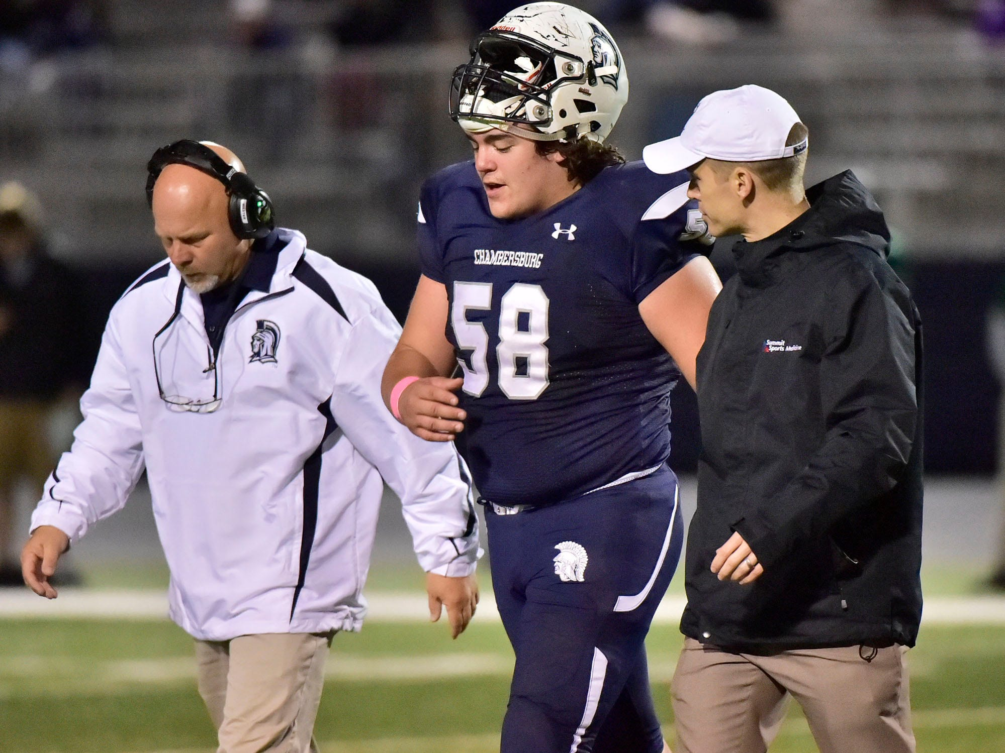Chambersburg's Tucker Karn (58) walks to the sideline following an injury. Chambersburg lost to Central Dauphin 35-14 in PIAA football on Friday, Oct. 19, 2018.
