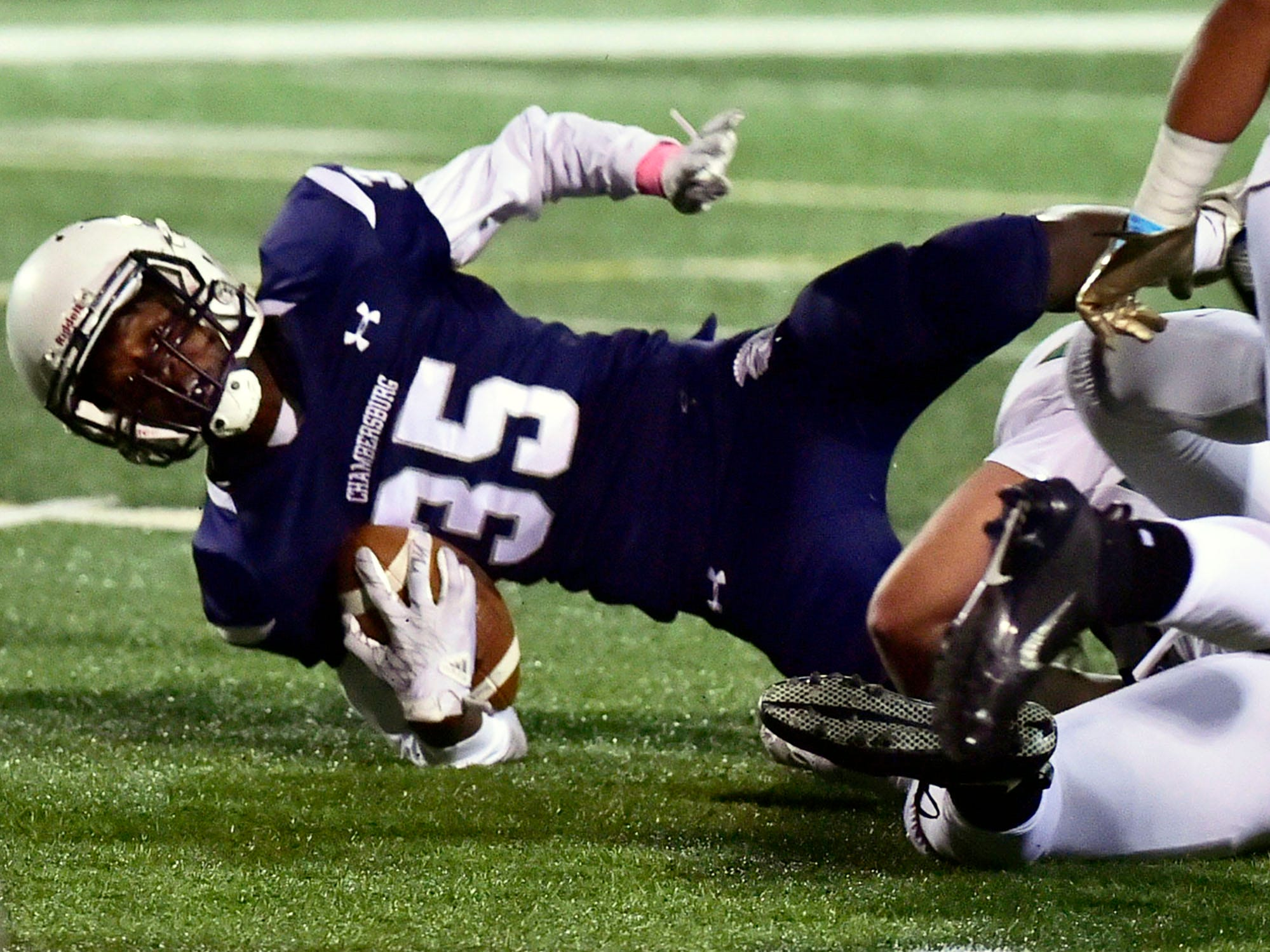 Chambersburg's DaQuan Rogers (35) is brought down after a short run. Chambersburg lost to Central Dauphin 35-14 in PIAA football on Friday, Oct. 19, 2018.