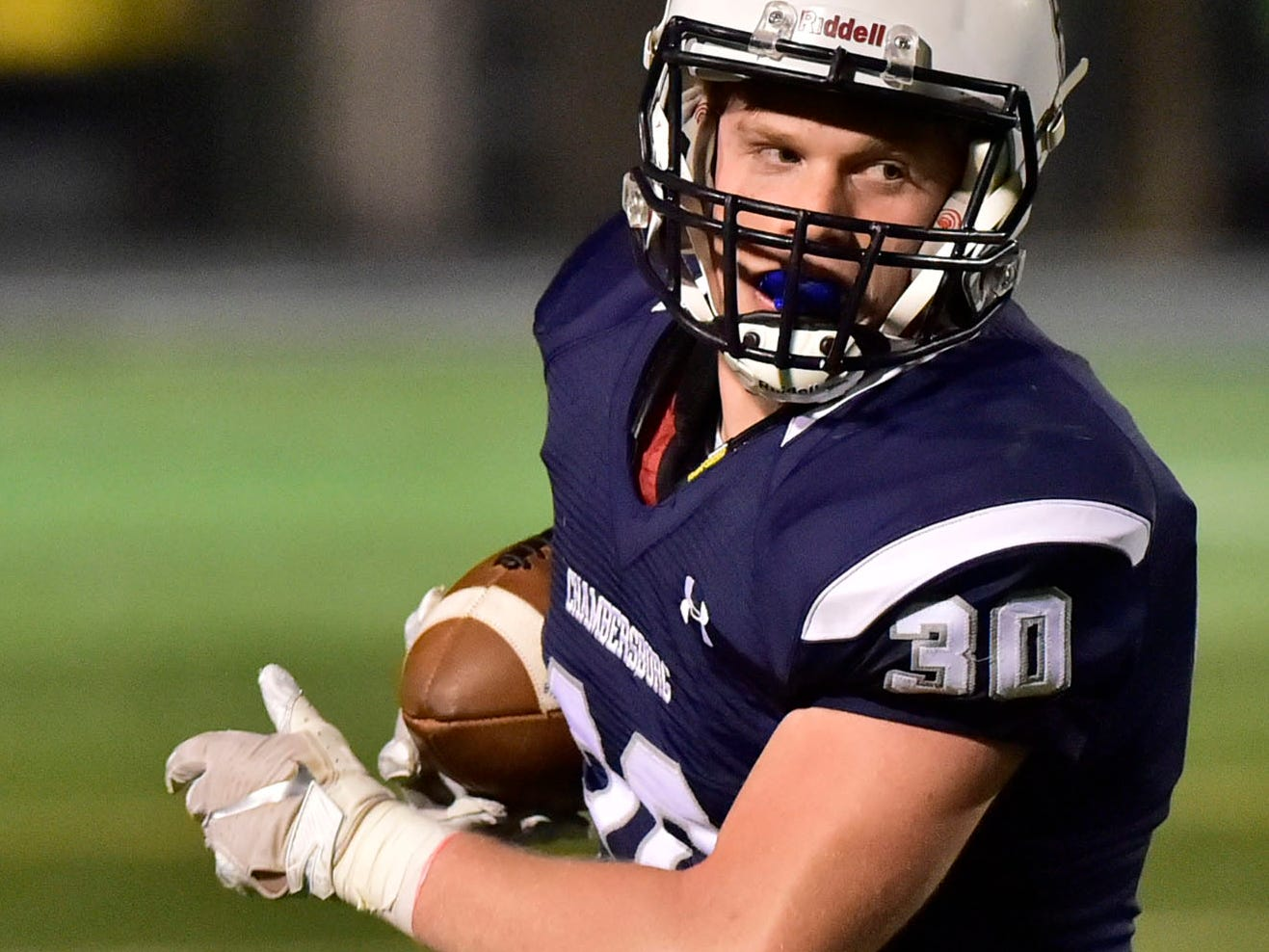 Chambersburg's Tanner Hunt runs the ball for the Trojans. Chambersburg lost to Central Dauphin 35-14 in PIAA football on Friday, Oct. 19, 2018.
