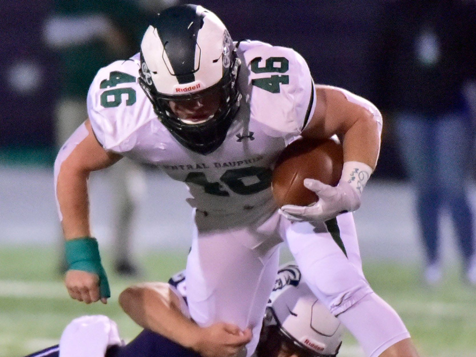 CD's Adam Burkhart (46) runs the ball before being tackled by Kyere Morton (20) Chambersburg lost to Central Dauphin in PIAA football on Friday, Oct. 19, 2018.