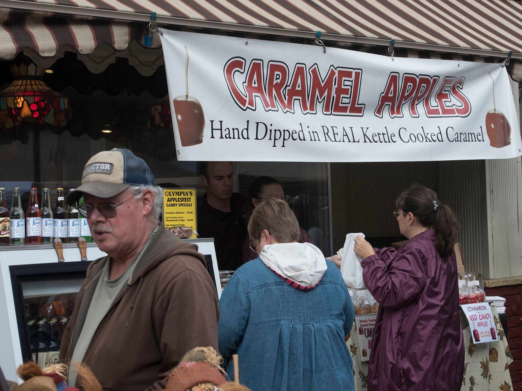 Olympia Candy Kitchen sells caramel apples. Applefest started Saturday morning October 20, 2018 in downtown Chambersburg.
