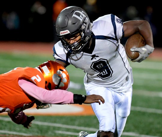 Dallastown running back Nyzair Smith, right, finished second in the league in rushing yards with 1,922 yards on 253 carries. DISPATCH FILE PHOTO