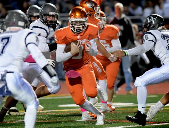 Central York quarterback Cade Pribula makes a running gain against Dallastown during football action at Central Friday, October 19, 2018. Bill Kalina photo
