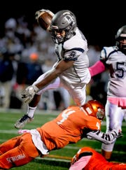 Dallastown running back Nyzair Smith avoids a tackle. Bill Kalina photo
