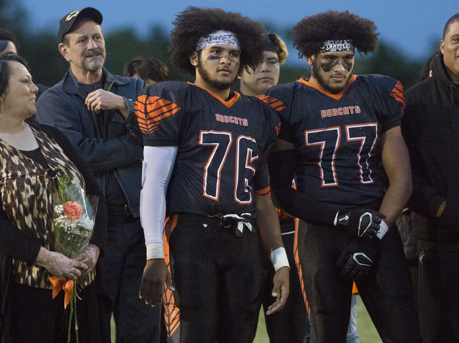 Northeastern High School honors members of the senior class prior to the game. York High defeats Northeastern 32-28 in football at Northeastern High School in Manchester, Friday, October 19, 2018.
