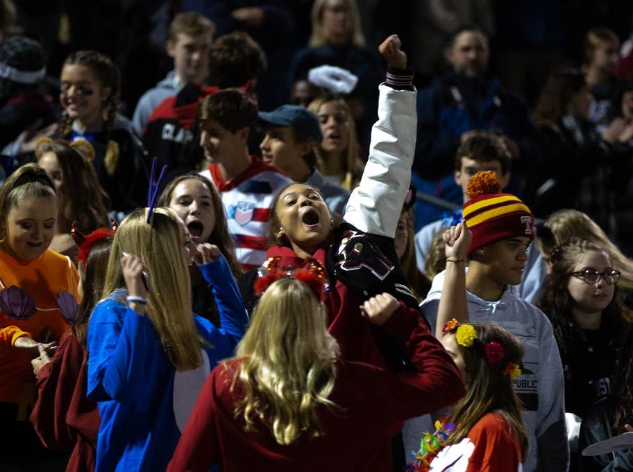 The South Western student section cheers during Friday's game against New Oxford.
