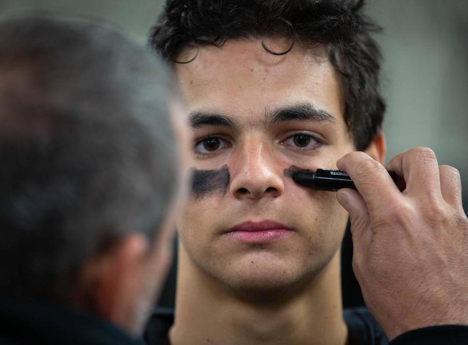 Getting some eye black is a tradition before every football game.