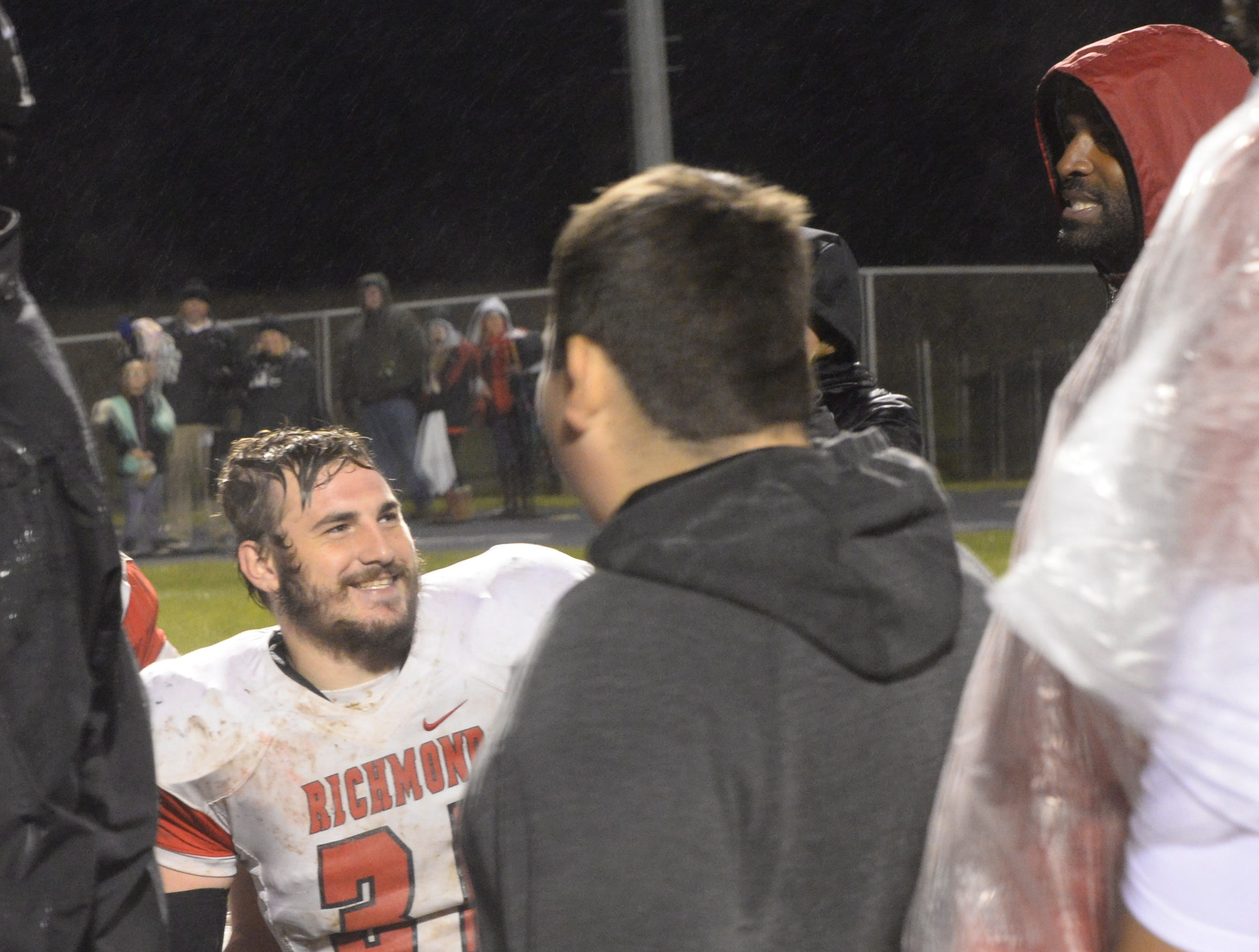 Brice Brown (35) smiles after the Richmond High School football team defeated Connersville 31-7 in the sectional opener Friday, Oct. 19, 2018.