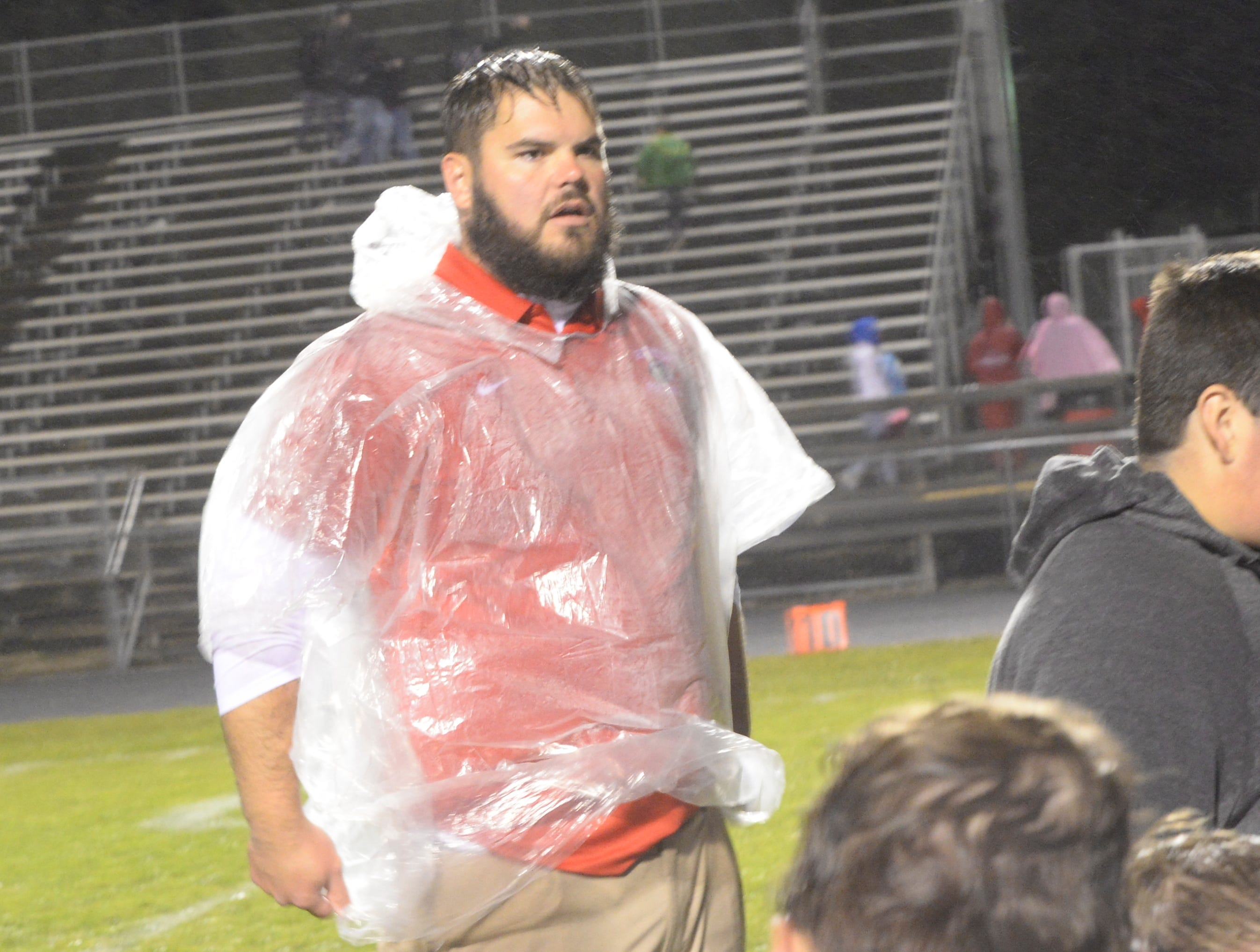 Assistant coach Kyle Fischer after the Richmond High School football team defeated Connersville 31-7 in the sectional opener Friday, Oct. 19, 2018.