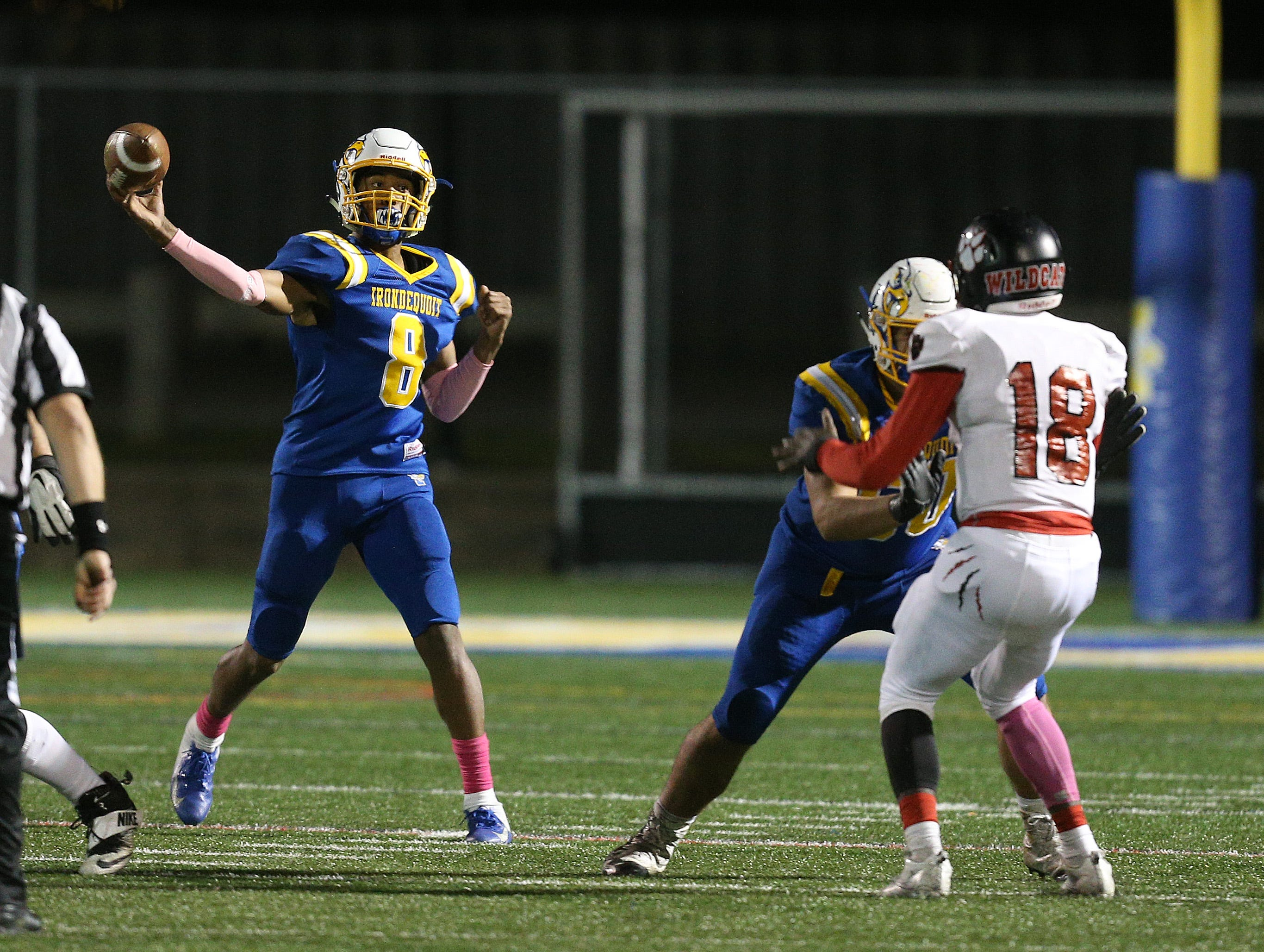 Irondequoit quarterback Freddy June Jr. stands in the pocket and delivers a pass over the middle.
