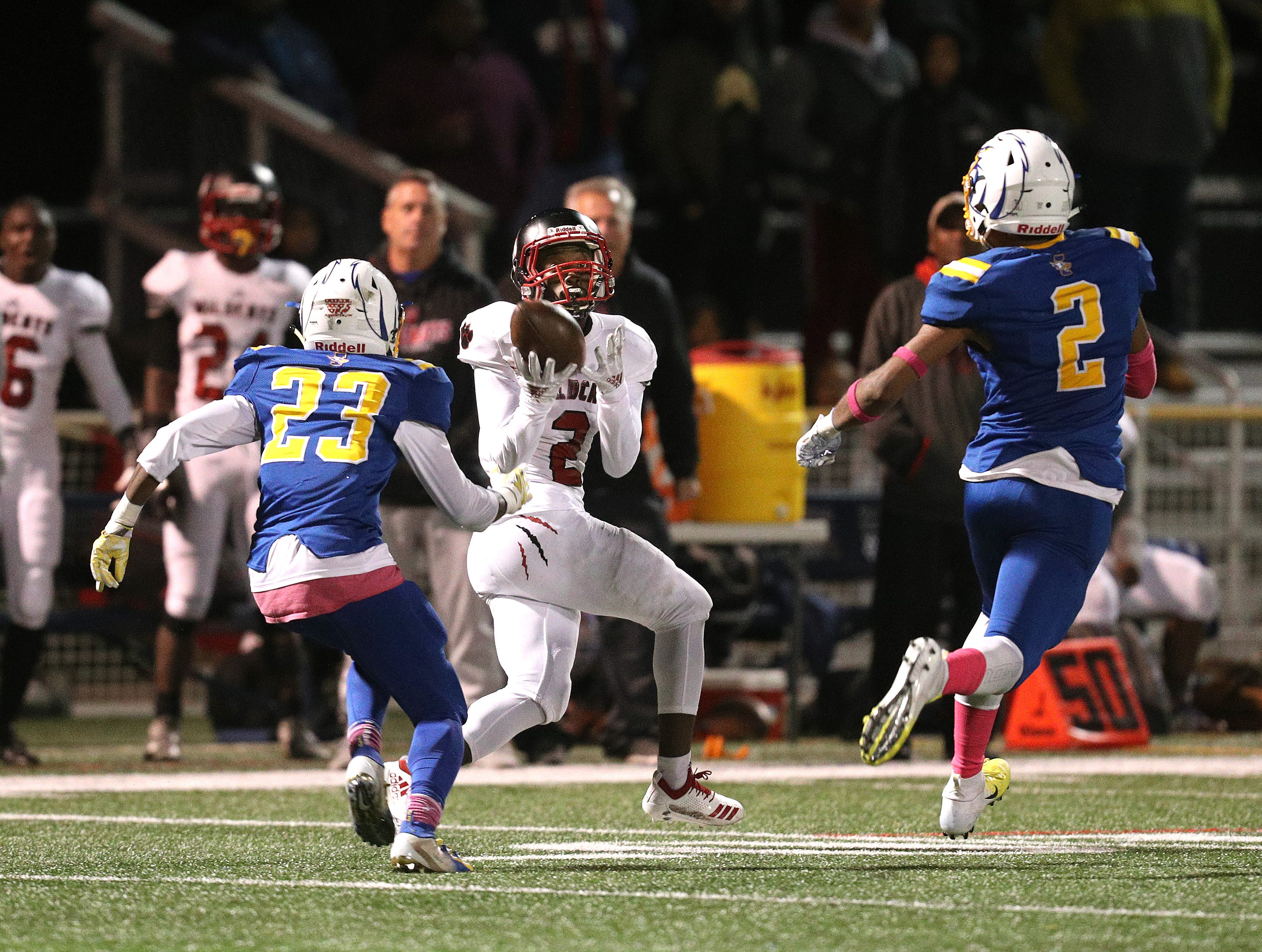 Wilson receiver Ricky Gamble Jr gets behind the Irondequoit defense to catch this 95-yard touchdown pass from quarterback Samuel Jackson.
