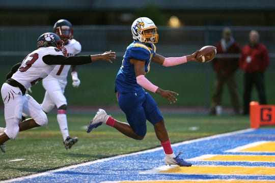 Irondequoit's Freddy June Jr. scores a touchdown in a 35-27 win over Wilson in Friday's Section V Class A quarterfinals.