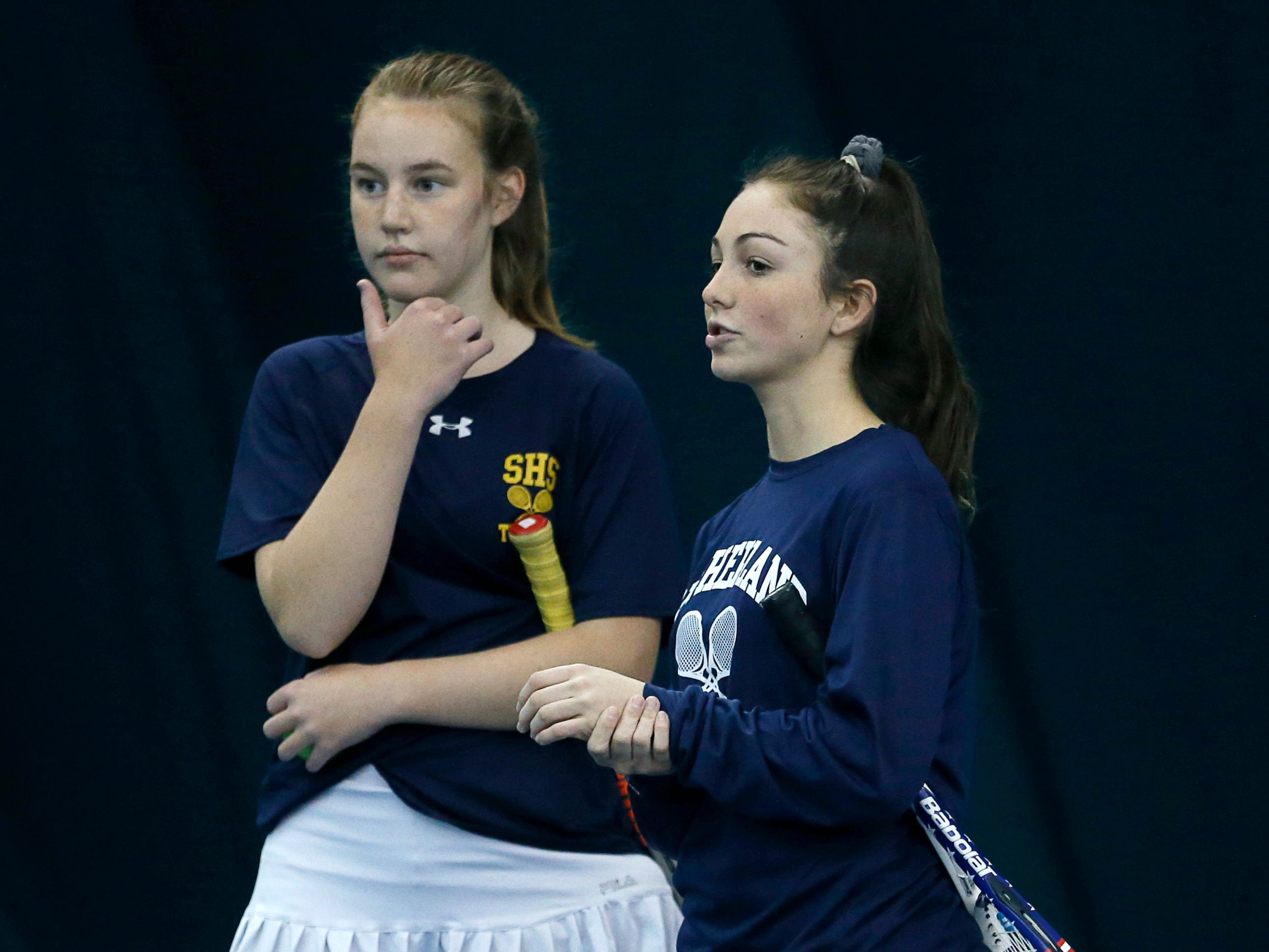 Pittsford Sutherland's Josie Libby and Gwenneth Mattia strategize during the doubles final of the Section V Tennis State Qualifiers at Mendon Racquet & Pool Club.