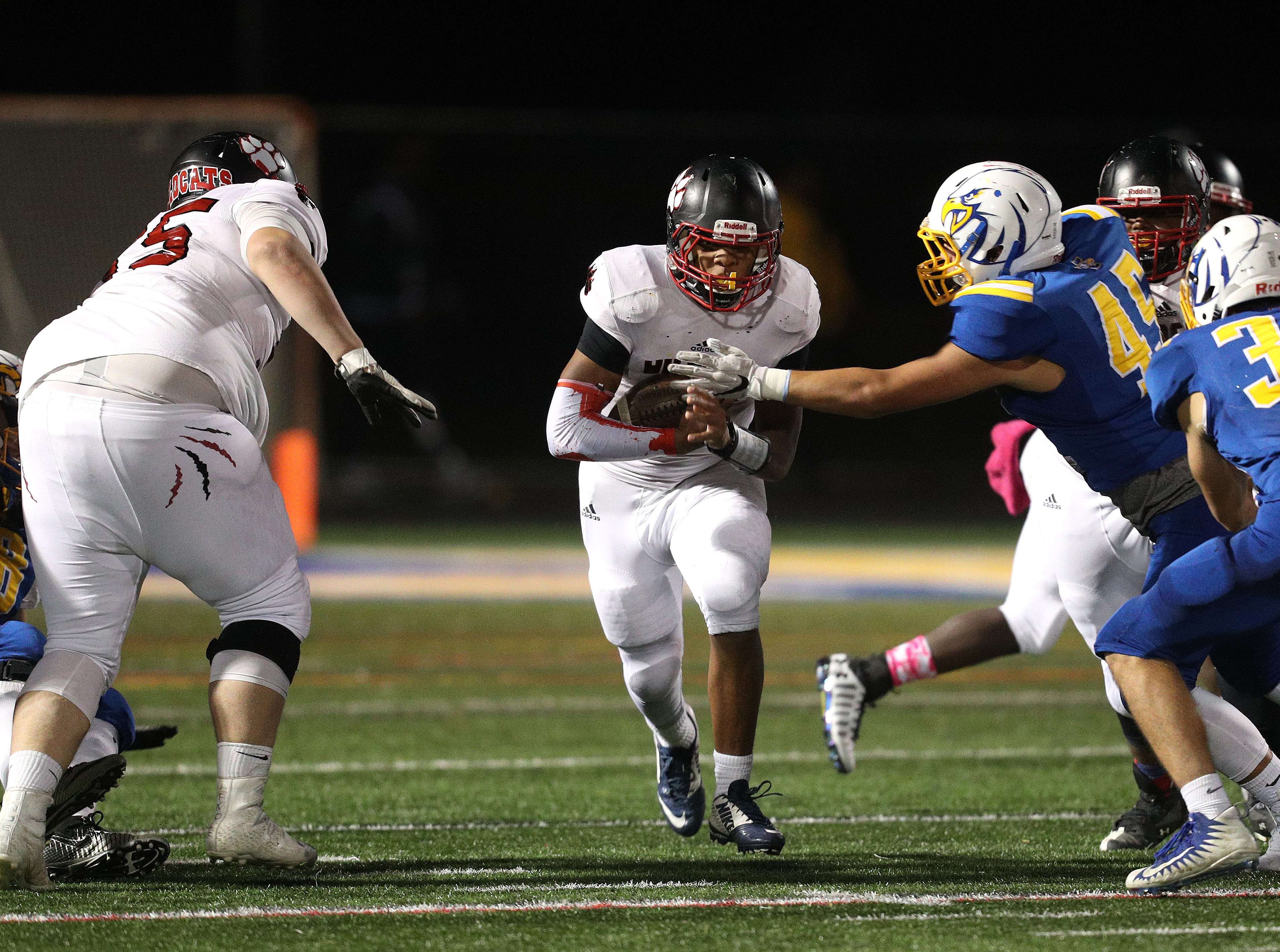 Wilson running back Desi Floyd Jr. finds a hole at the line of scrimmage against Irondequoit.