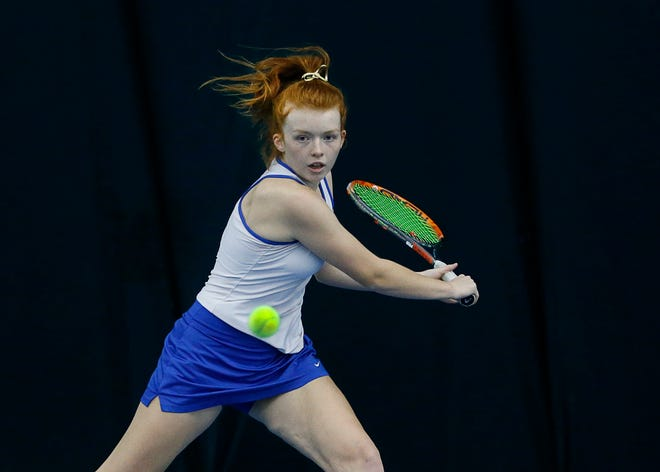 Webster's Catherine Gamble in the singles final during the Section V Tennis State Qualifiers at Mendon Racquet & Pool Club. Gamble defeated Anastasia Gubanova of Harley-Allendale Columbia 4-6, 6-4, 6-4 for the title.