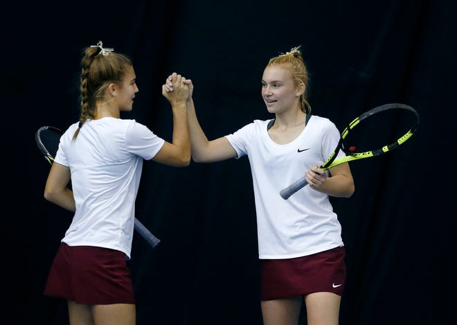 Pittsford Mendon's Sarah Bodewes high-fives her sister Jess during the doubles final of the Section V Tennis State Qualifiers at Mendon Racquet & Pool Club. Sarah and Jess won 6-1, 6-1, on Oct. 20, 2018.
