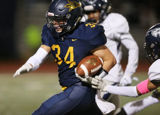 Victor's Joey Pezzimenti breaks off a huge run in the third quarter against Eastridge.