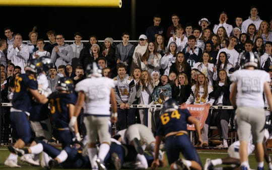 Victor fans cheer after their team sacked the Eastridge quarterback on Friday night.
