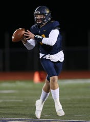 Victor's James Knapp looks for a receiver against Eastridge on Friday.