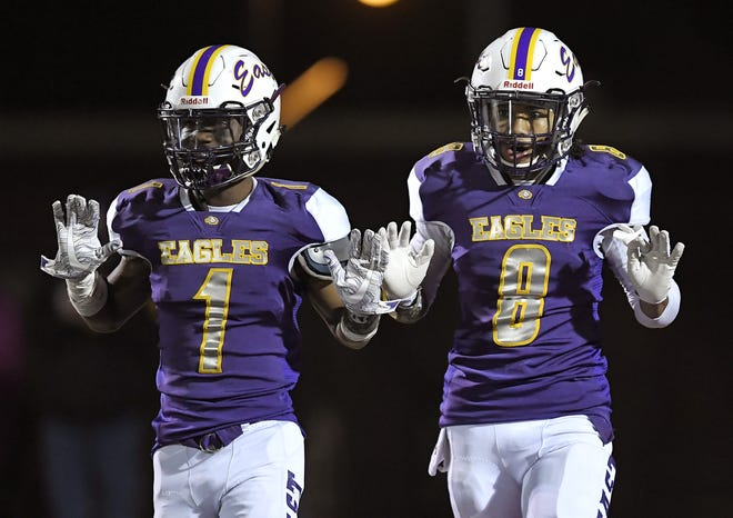 East's Freddie Brock Jr., right, celebrates a 51-yard touchdown with Malik McCray during the fourth quarter of Friday night's 14-7 win over Greece Arcadia.
