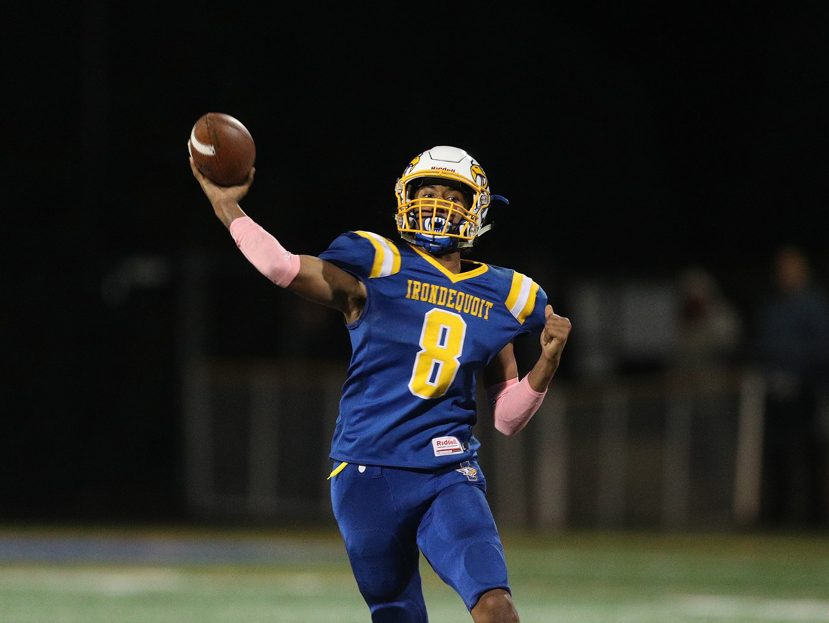 Irondequoit quarterback Freddy June Jr. makes this pass while rolling to his right.