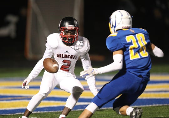Wilson's Rickey Gamble Jr. watches this kickoff bounce near the goal line in front of Irondequoit's Ryan DeRosa.  Wilson retained the ball at the two yard line.