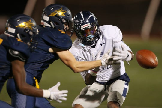 Victor's Sutton Boland breaks up this pass to Eastridge Tony Arnold.