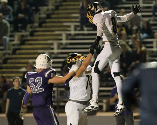 Enterprise's Norberto Revuelta (8) celebrates with teammate, Brandon Porter (74), in the end zone after he scored a touchdown in the 2nd quarter.   The Wolves beat the Hornets, 47-10, to win the 26th River Bowl at home on Friday, Oct. 19, 2018.