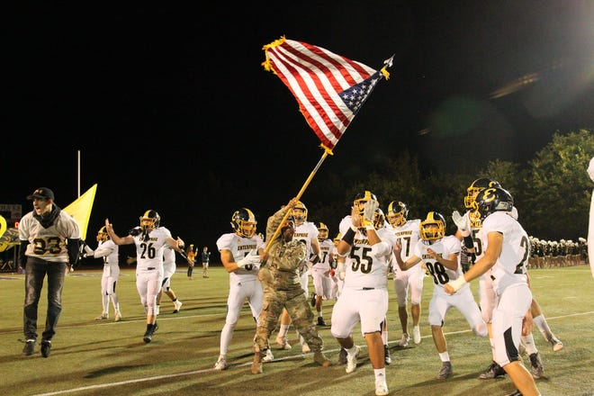Enterprise's players take the field before a game against Shasta on Oct. 19.