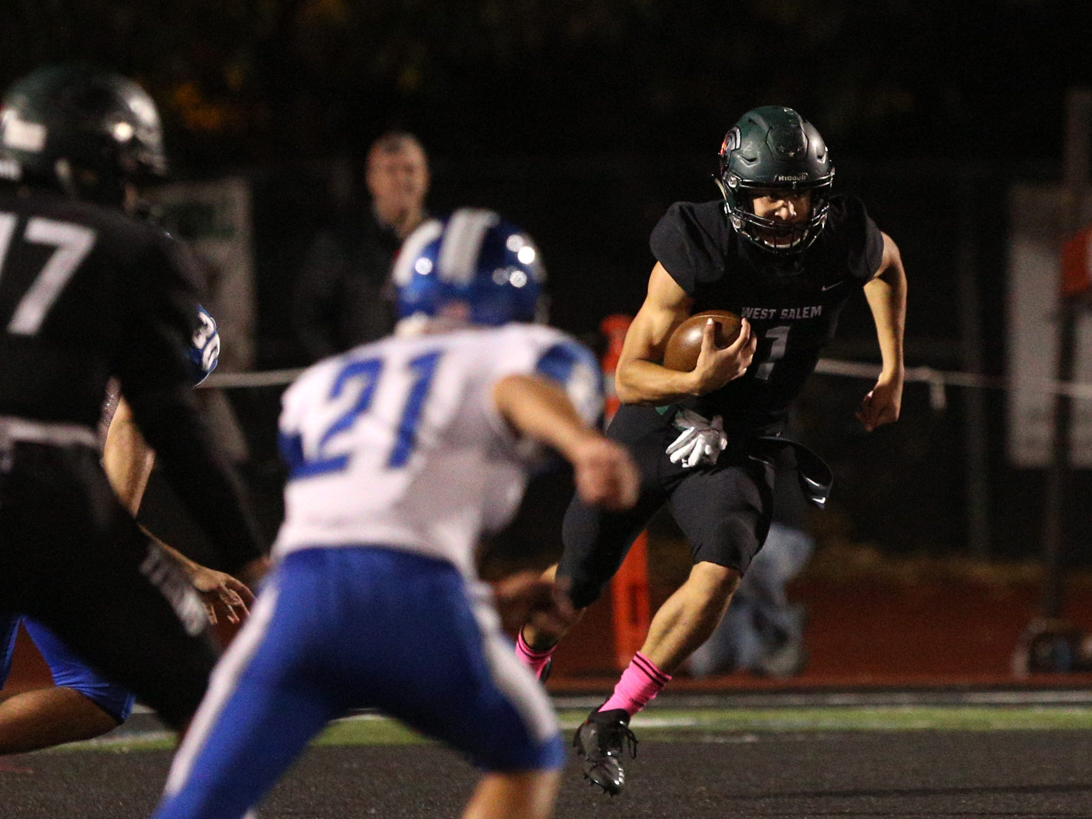 West Salem's Simon Thompson (1) runs the ball in during the first half of the McNary vs. West Salem football game at West Salem High School on Friday, Oct. 19.