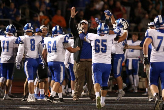 McNary celebrates on the sidelines after an interception during the first half of the McNary vs. West Salem football game at West Salem High School on Friday, Oct. 19.