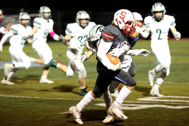 South Salem's Kellen Goodman (17) rushes in the second half of the Summit vs. South Salem football game at South Salem High School on Friday, Oct. 19, 2018. Summit won the game 25-21.