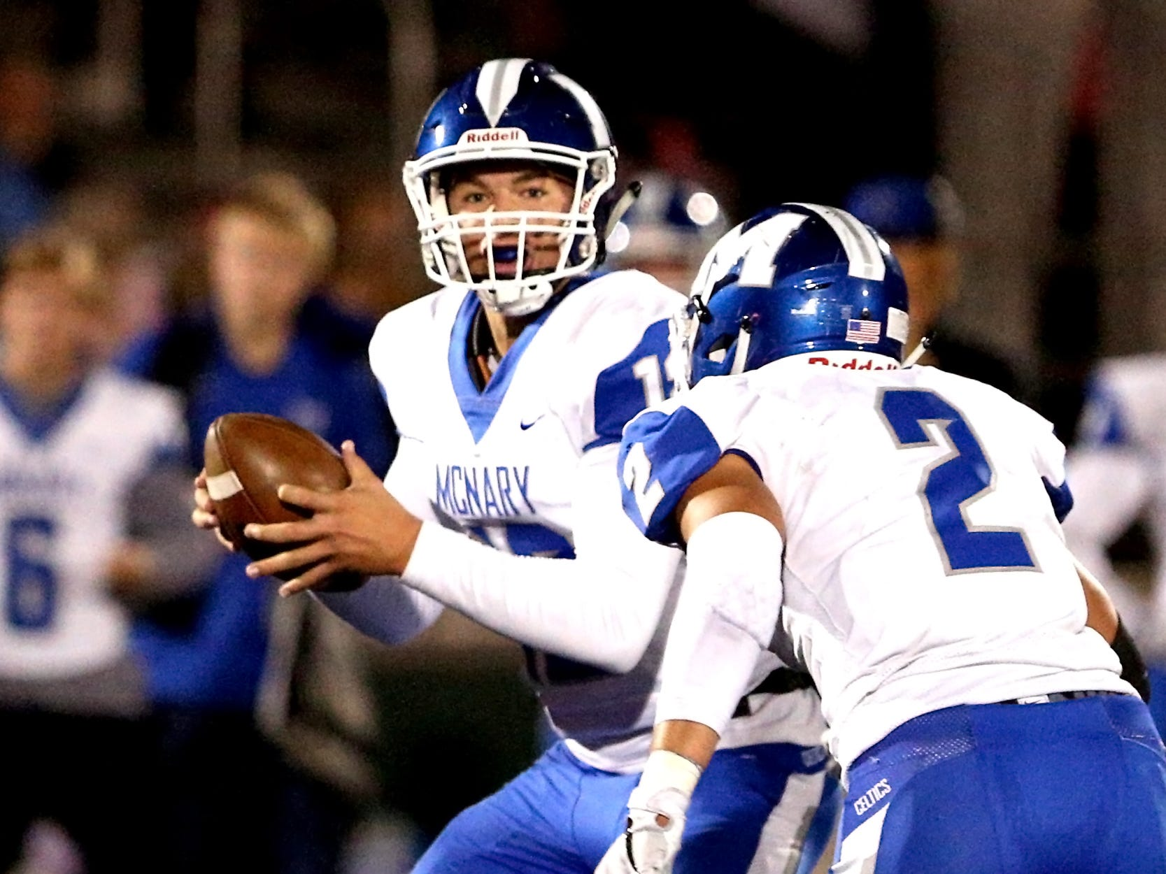 McNary's Erik Barker (12) looks to make a pass during the first half of the McNary vs. West Salem football game at West Salem High School on Friday, Oct. 19.