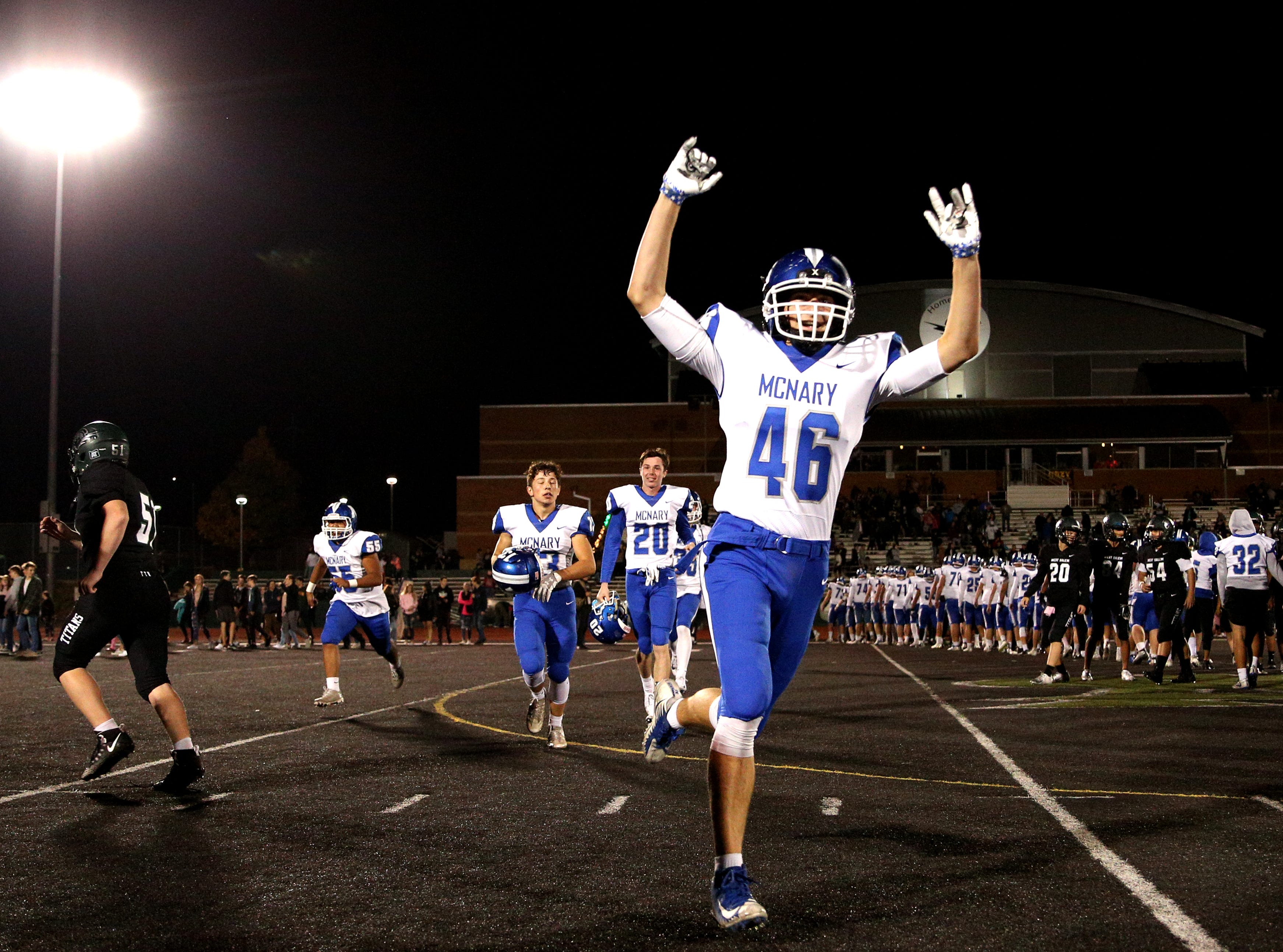 McNary's Griffin Hubbard (46) celebrates after his team defeated West Salem, 35-23, at West Salem High School on Friday, Oct. 19.