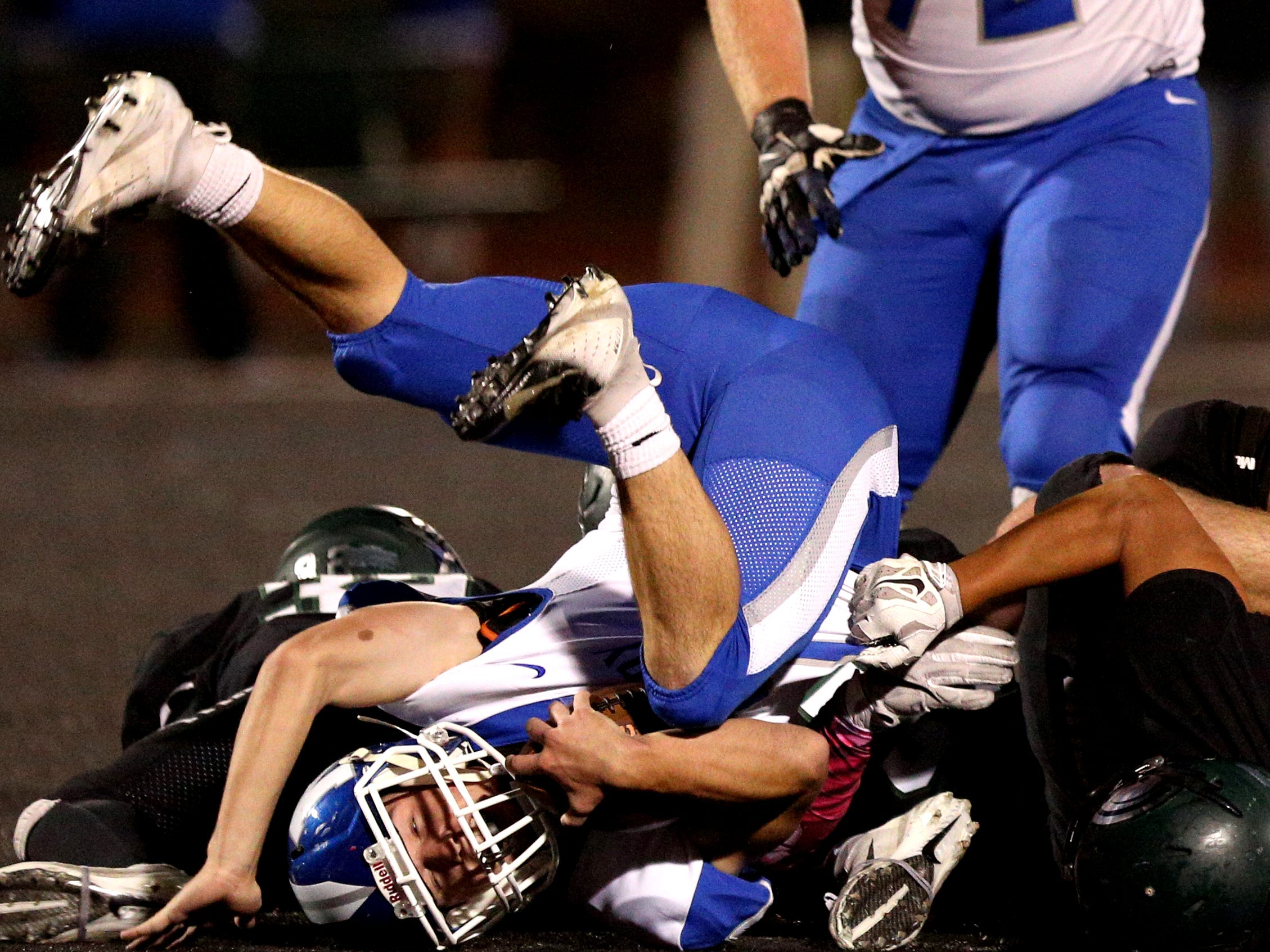 McNary's Robert Benson (7) is tackled during the first half of the McNary vs. West Salem football game at West Salem High School on Friday, Oct. 19.