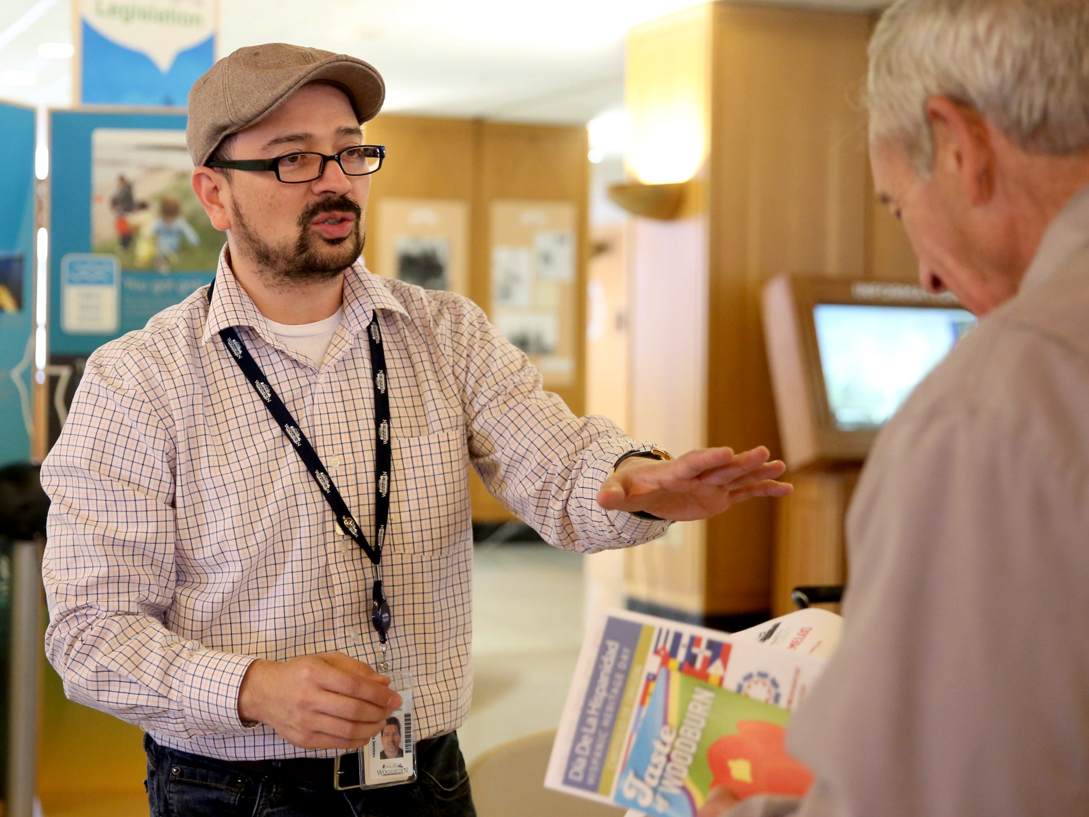 Gustavo Gutierrez-Gomez, left, a community relations manager with the city of Woodburn, gives out information of the city during Hispanic Heritage Day at the Oregon State Capitol on Saturday, Oct. 20, 2018.
