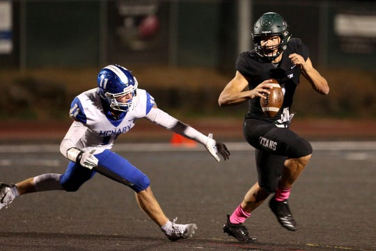 West Salem's Simon Thompson (1) rushes past McNary's Noah Bach (11) during the first half of the McNary vs. West Salem football game at West Salem High School on Friday, Oct. 19.